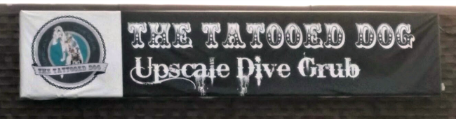 The Tattooed Dog sign
