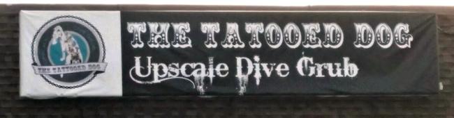 The Tattooed Dog sign